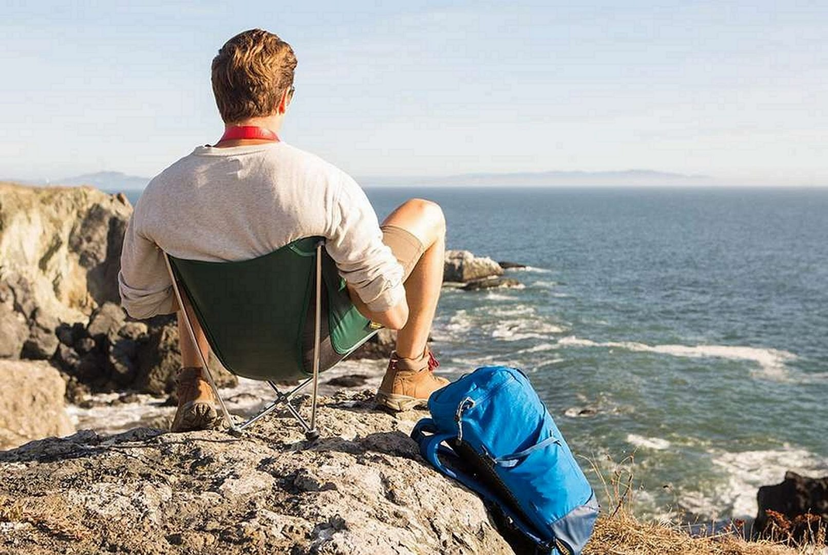 man on a chair by the sea Best Backpacking Chair