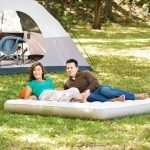 man and woman on the bed for camping