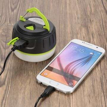 charging the smartphone from camping lantern