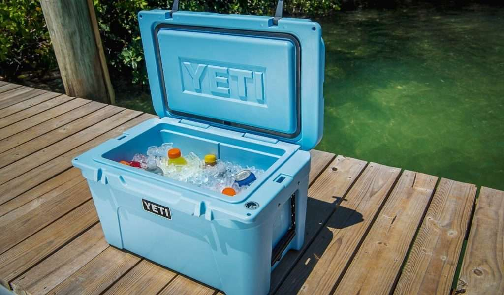 open Yeti cooler with ice and drinks inside