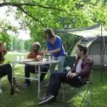 people at the table for camping
