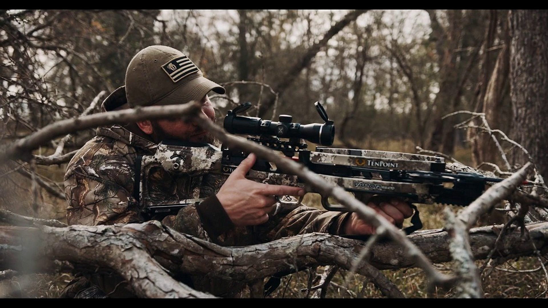 A Hunter Aims through a Scope of a Crossbow