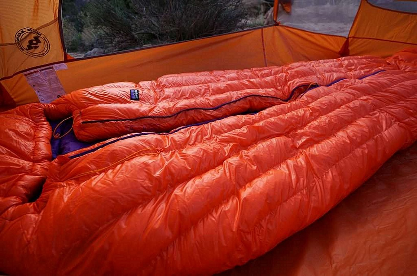 Red sleeping bag inside a tent