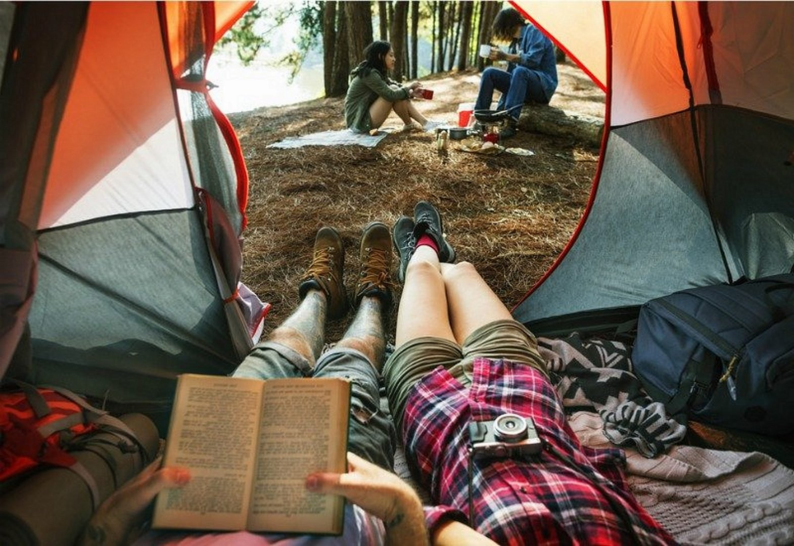 Reading book in a tent when camping