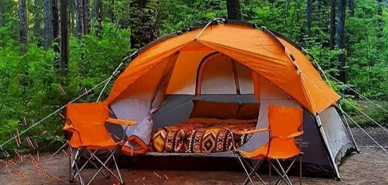 Orange Tent in the Woods