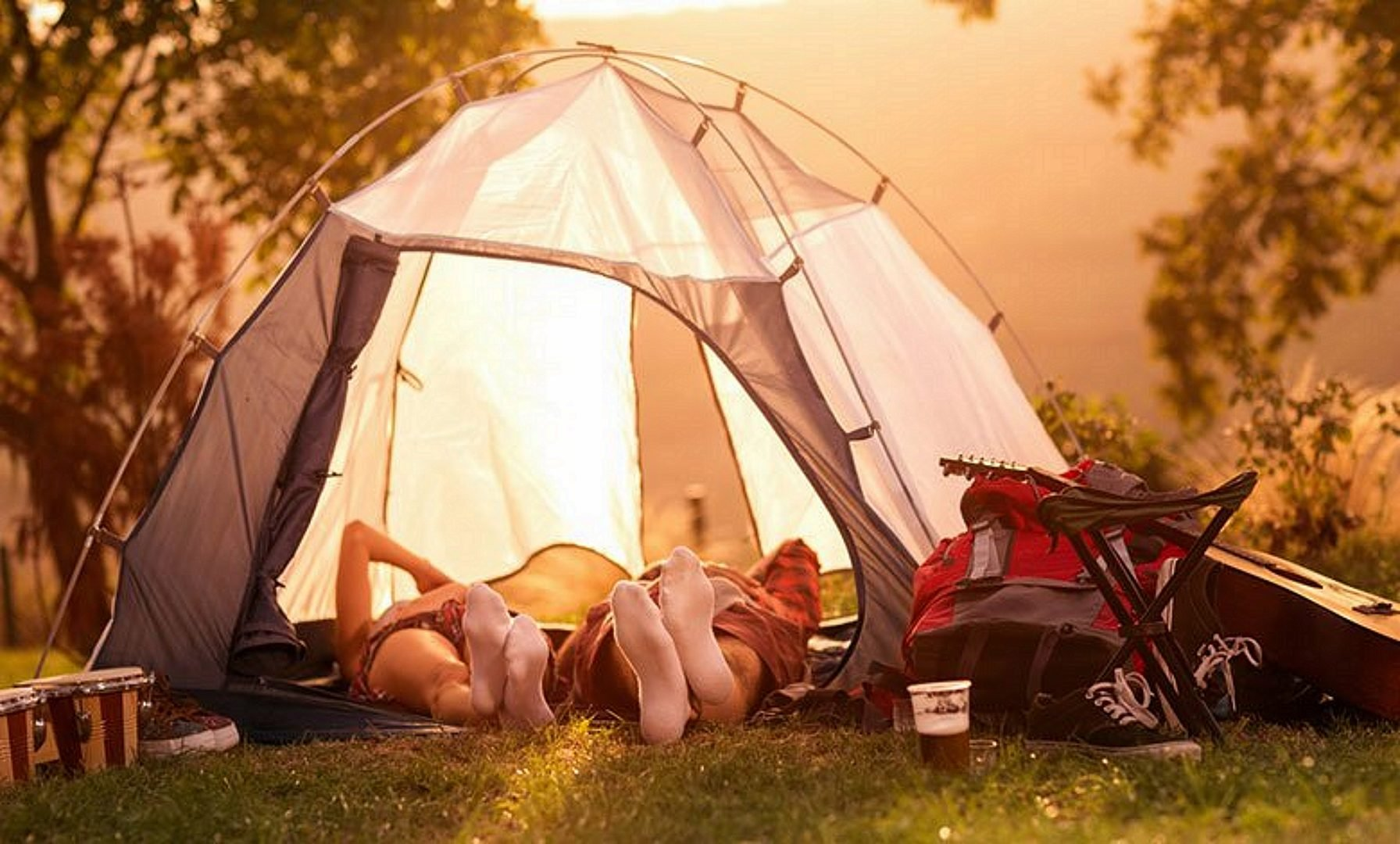 Camping in a white tent