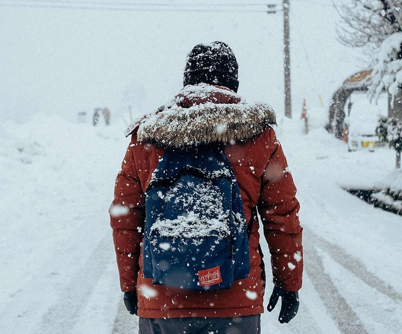 man with a backpack under the snow
