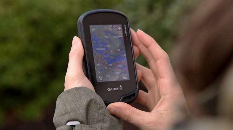 handheld GPS in hand