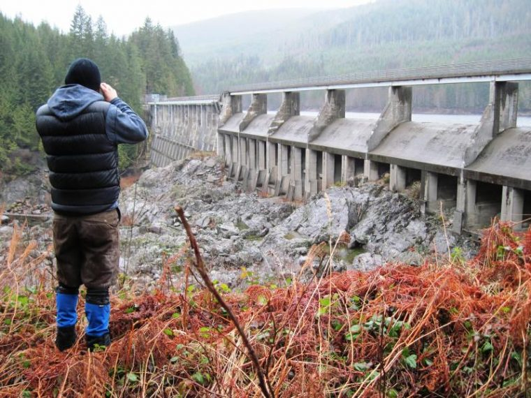 man in gaiters looking at the bridge nature mountains forest