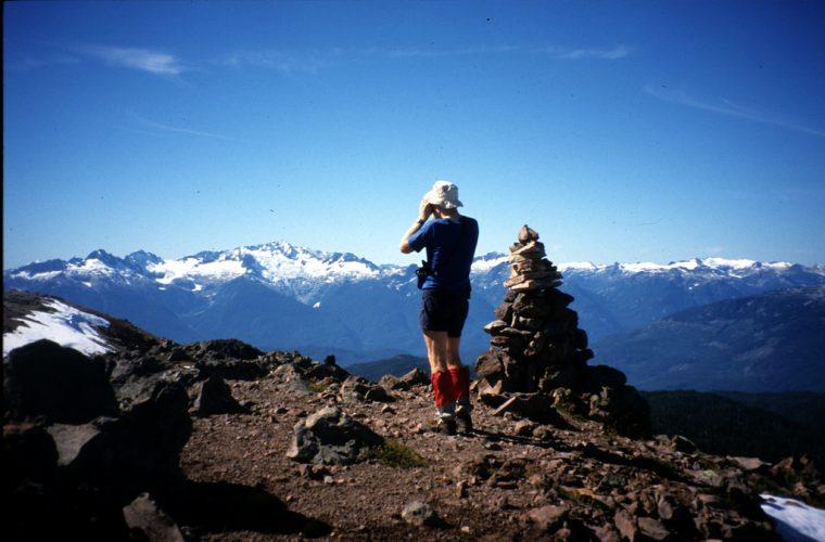 man in gaiters hiking mountains