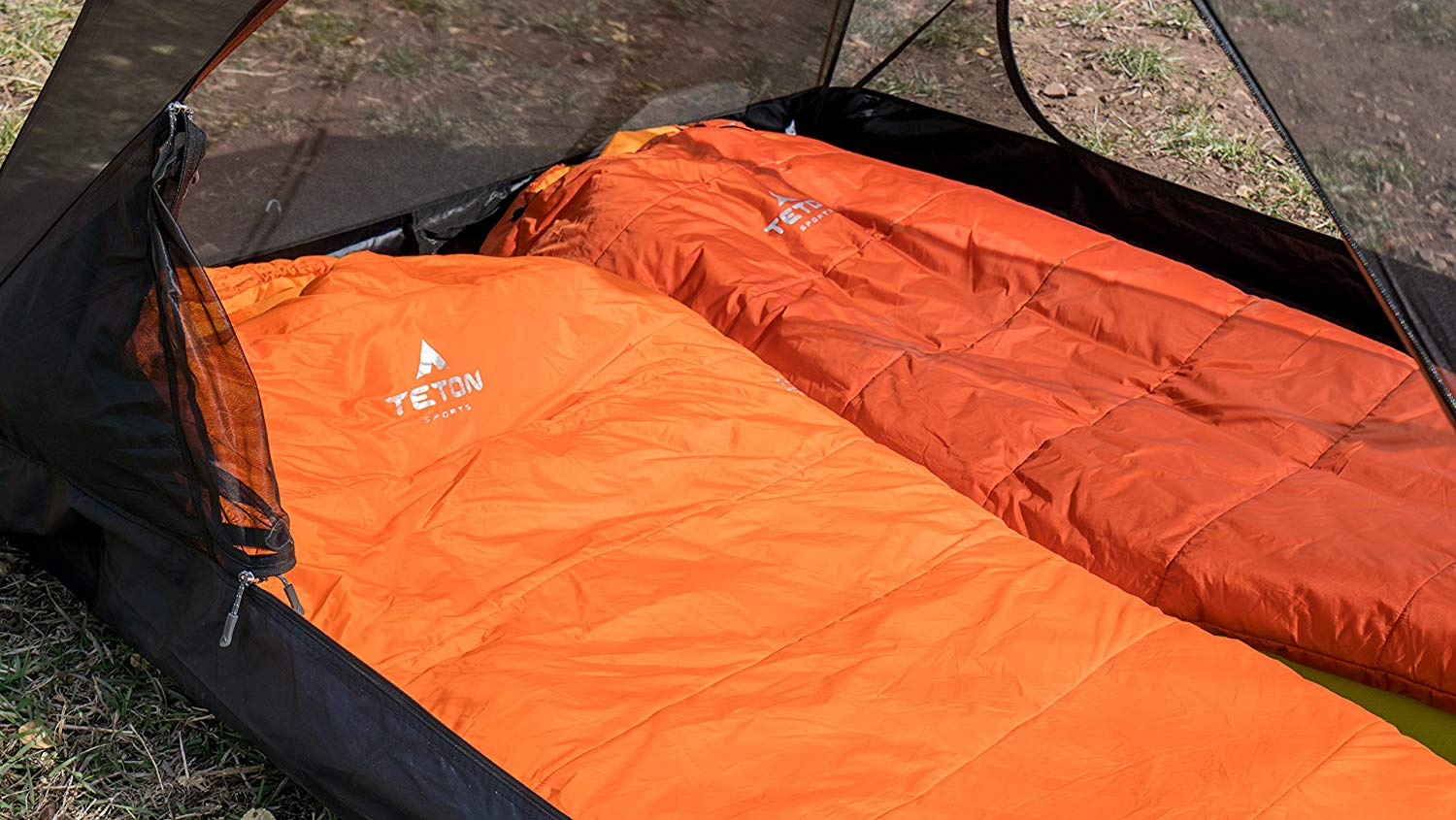 Photo of 2 sleeping bags inside a tent. TOP 7 Best Sleeping Bags Under 200 – Make your camping comfortable, yet affordable!