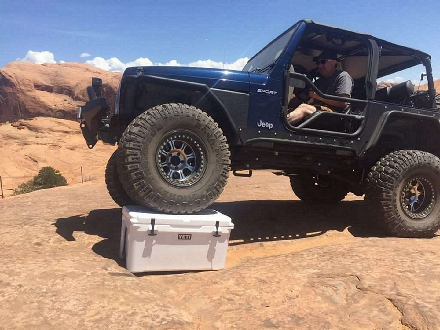 Durability of a Yeti Cooler Being Tested by a Jeep